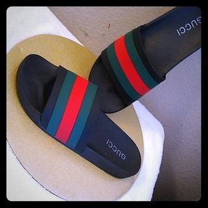Gucci black rubber slides